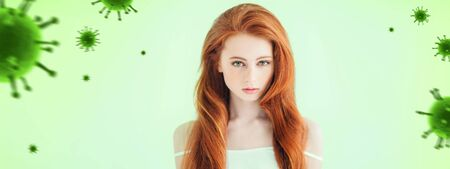 Redhead beautiful young girl on a green background with bacterial molecules. Epidemic, viruses, healthcare. Copy space. Imagens