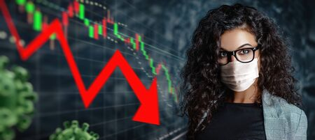 Business and coronavirus. Portrait of a businesswoman in a medical mask on the background of graphs showing the global economy crisis due to COVID-19. Copy space.
