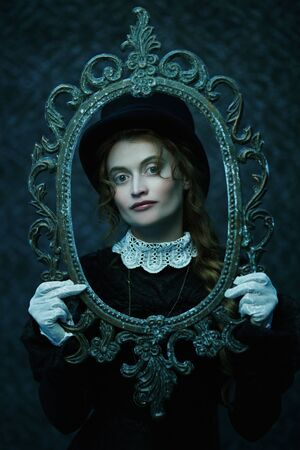 Portrait of a beautiful Victorian woman in an old vintage frame. Steampunk.