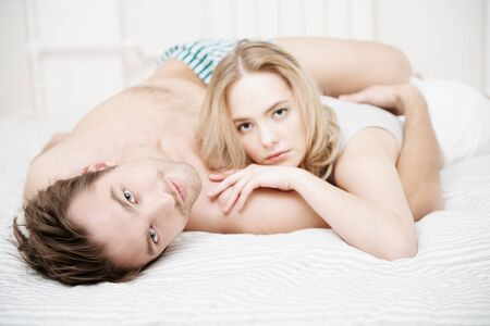 COVID-19 and life. Two young people in love enjoy quarantining at home. Staying at home and social distancing. Stock Photo