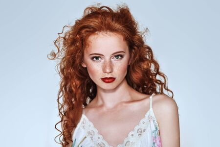 Beautiful young woman with long red hair. Hair care, hair coloring. Copy space. Foto de archivo