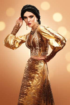 Oriental beauty woman. Portrait of a beautiful arabian woman in traditional dress, with traditional oriental make-up and black hijab. Make-up and cosmetics.