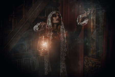 A portrait of a redhead witch with a lantern in her lair. Magic, dark force, spell.