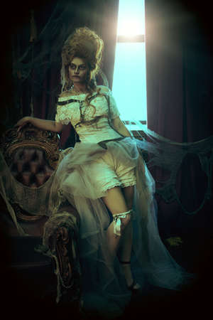 Halloween Portrait of the dead empress in the old abandoned castle. Ghost in the castle. Vintage style.