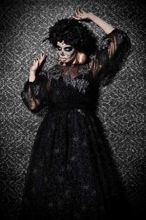 Beautiful Calavera Catrina over vintage background. Fashion model with sugar skull makeup. Dia de los muertos. Day of The Dead. Halloween.