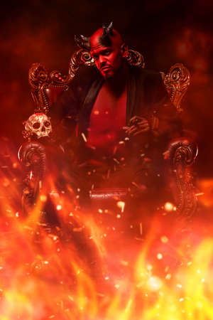 A portrait of a bad demon in his throne with a skull and cigar in fire. Horror movie, nightmare. Halloween.