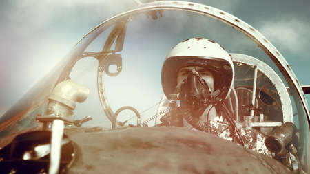 Portrait of a man pilot wearing helmet and a mask in cockpit of fighter jet. Military aircraft. Banque d'images