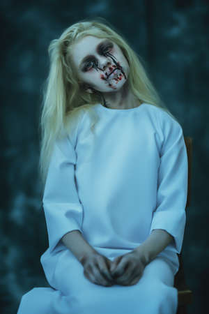 Portrait of a scary pale girl from horror film. Zombie, halloween. Banco de Imagens
