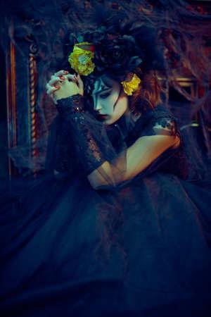 Charming and dangerous Calavera Catrina in an old castle. Sugar skull girl. Day of The Dead. Dia de los muertos. Halloween.