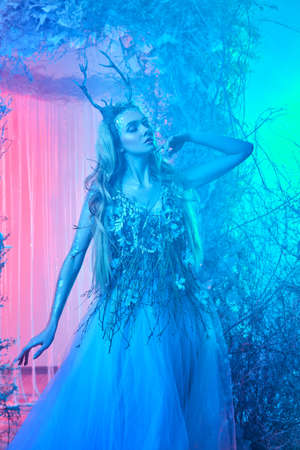 Fabulous forest nymph in a magical winter forest. Fairy world.