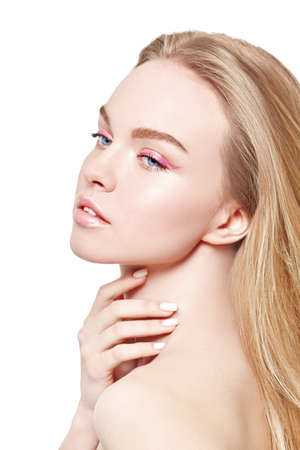 Beauty and spa. Portrait of a beautiful blonde girl with light fresh makeup in pink make up on a white background. Skin care. Makeup and cosmetics.