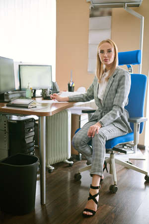 Successful women in business. Portrait of a beautiful modern business woman working in the office. Business concept.