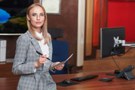 Business concept. Beautiful successful business woman working in the office. Successful women in business.