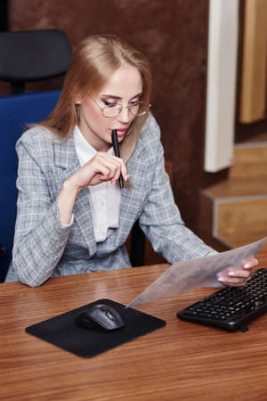 Modern business woman working in her office. Business concept.