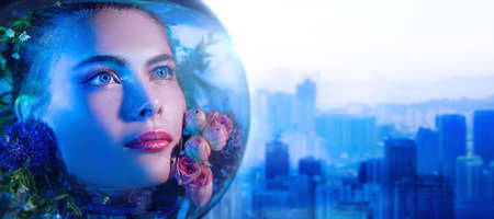 Environmental disaster, air pollution. Beautiful girl in a spacesuit filled with flowers looks up with hope against the backdrop of a large industrial city. Copy space.