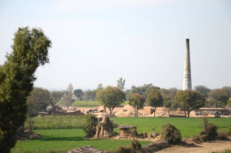 brick kiln: Farms near Brick Kiln Chimney Editorial