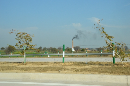 brick kiln: Polluting Smoking Brick Kiln Chimney at Country Side