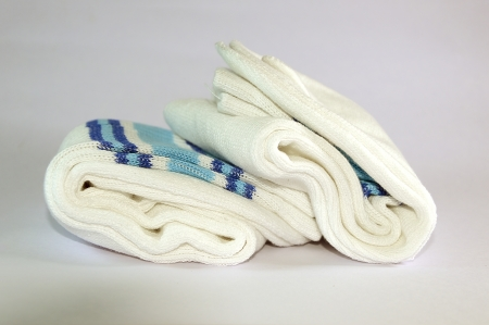 Two Socks rounded and folded on white background  The socks are of cotton and very soft   photo
