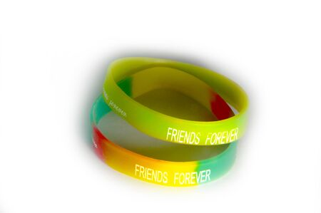wristbands: Frindship forever text on two wristbands  The objects are on white background and shadows  Stock Photo