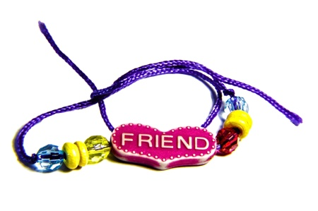 Friendship band of blue thread and different beads   Stock Photo