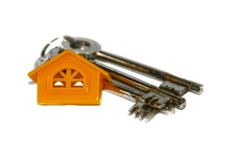 Home and three keys on white background. Real estate symbols. photo