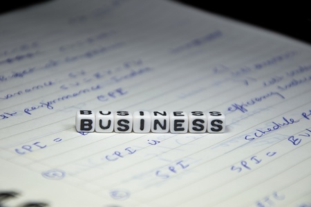 Business Text on Management notebook photo