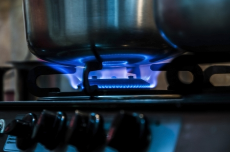 stovetop: Pot on fire and flames in kitchen for making food  Kitchen scene with pots and flames   Stock Photo