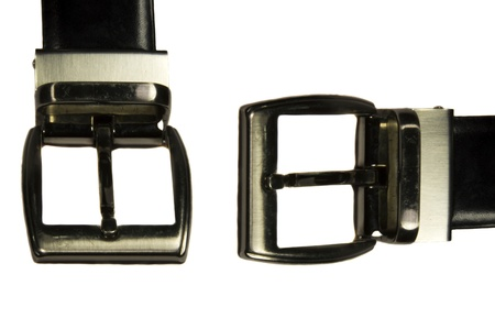 Two buckles of leather belts on white background   photo