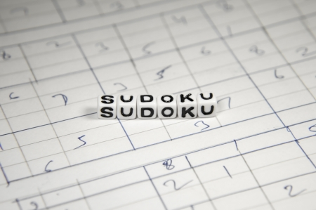 Homemade Sudoku game and its alphabet letters and text  Stock Photo - 20876576