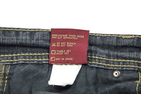 Washing and dry-cleaning instructions for Jeans  The cotton tag attached with cloth   photo