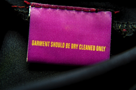 guideline: Cloth having specific instructions for dry-cleaning it only  Message on top of the tag   Stock Photo
