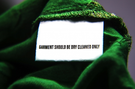 dry cleaned: Dry clean only instructions for cloth washing  White tag on the cloth   Stock Photo