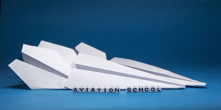 Aviation school letters and alphabets on blue background. Conceptual image showing aviation study places.  photo