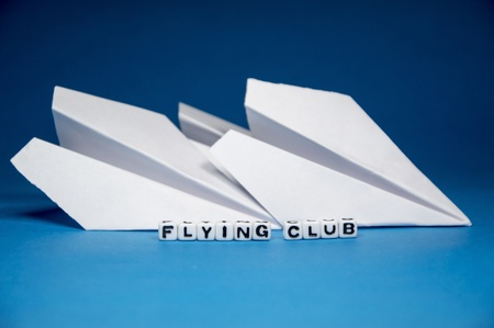 Flight and flying club conceptual image with related objects on blue background   photo