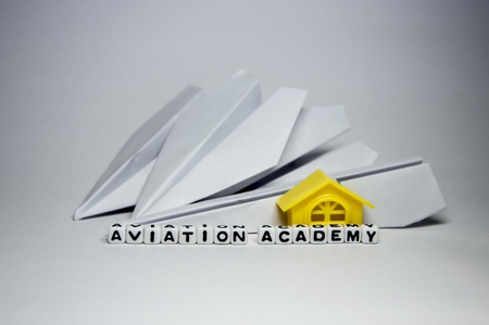 AViation academy conceptual image with planes, letters and building block   photo