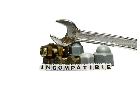 incompatible: Incompatible parts and gears with tools on white background  Stock Photo