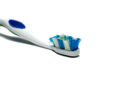 Old toothbrush which has been used on the background