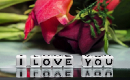 I love you message with flowers and alphabetical text   photo