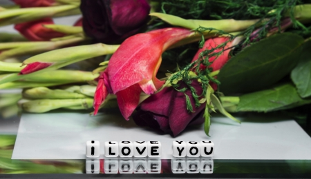 I love you message with flowers and text on reflective surface  photo