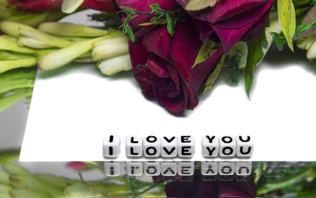 I love you message with rose and other flowers on white background and a frame  photo