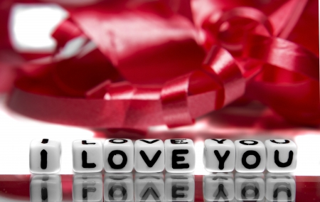 I love you message with red ribbon in background  Overall theme is red and white   photo