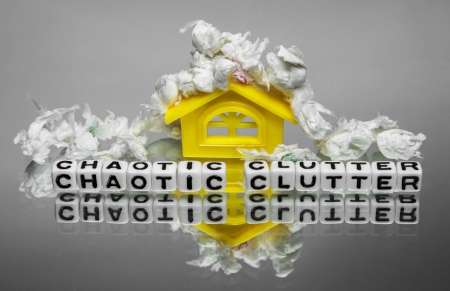 disorganize: Chaotic clutter around home with papers  It is in a conceptual image showing clutter