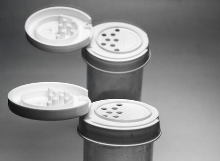subtle background: Salt container with lid open on subtle background  Stock Photo