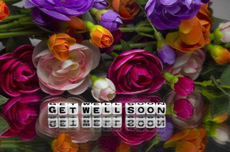 get well: Get well soon message with many flowers. Stock Photo