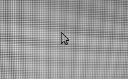 Real arrow cursor on black and white mesh of pixel grid.  photo