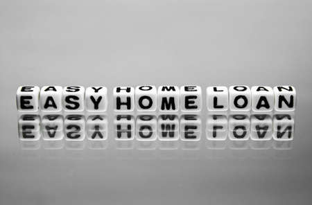 homeownership: Simple easy home loan message on the reflective surface.