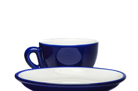 Blue cup and saucer on white background   photo