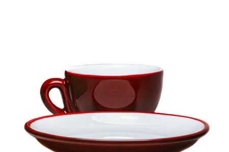 Red cup and saucer on white background   photo