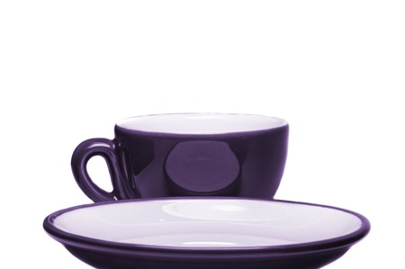 Purple cup and saucer on white background  photo