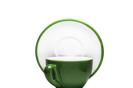 Green cup and plate on white background photo